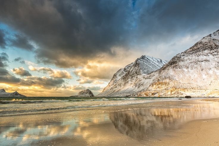 ... arctic light - During the winter season the arctic sun remains most of the time on a very low angle. This gives a golden lightning to the whole scenery. To capture the dynamic range of sky and foreground I used some Lee GND filters. The picture was taken in February 2015 at Haukland Beach – Lofoten Islands, Norway.