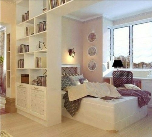 Beautiful space for sleeping, working and reading.  Floor to ceiling shelves make great space divider.