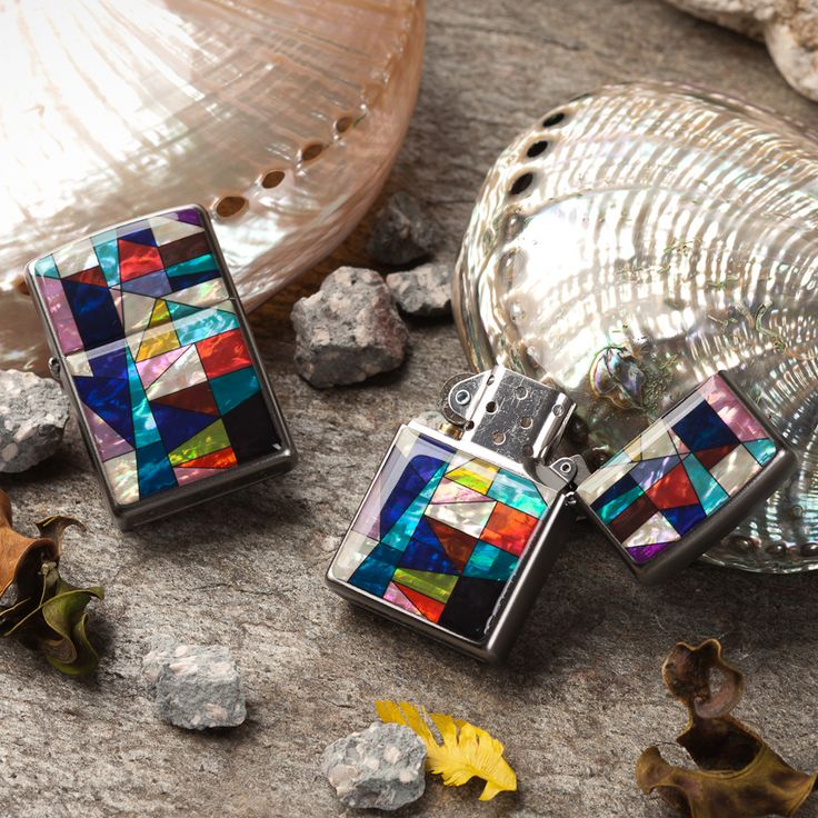 http://www.antiquealive.com/store/detail.asp?idx=5166&CateNum=167&pname=Zippo-Mother-of-Pearl-Cigarette-Lighter-with-Patchwork-Design  Zippo Mother of Pearl Cigarette Lighter with Patchwork Design