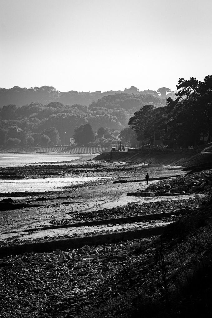 Mumbles Haze  5/7 in the nature challenge. View looking along the beach front on the Swansea foot and cycle path along the bay towards Mumbles. A slight heat haze and a low sun created a layered light effect as well as high contrast shadows.  Canon 700D EF-S 55-250mm f4-5.6 IS @ ISO 200 109mm f13 1/180sec