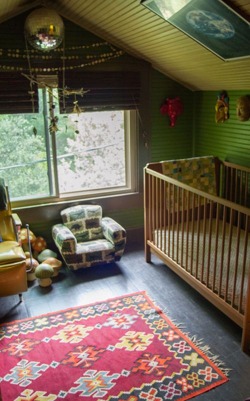 What a cute baby room with a cabin feel.  Have to get that Oriental rug I keep talking about. I like how this one looks against the wood floor.
