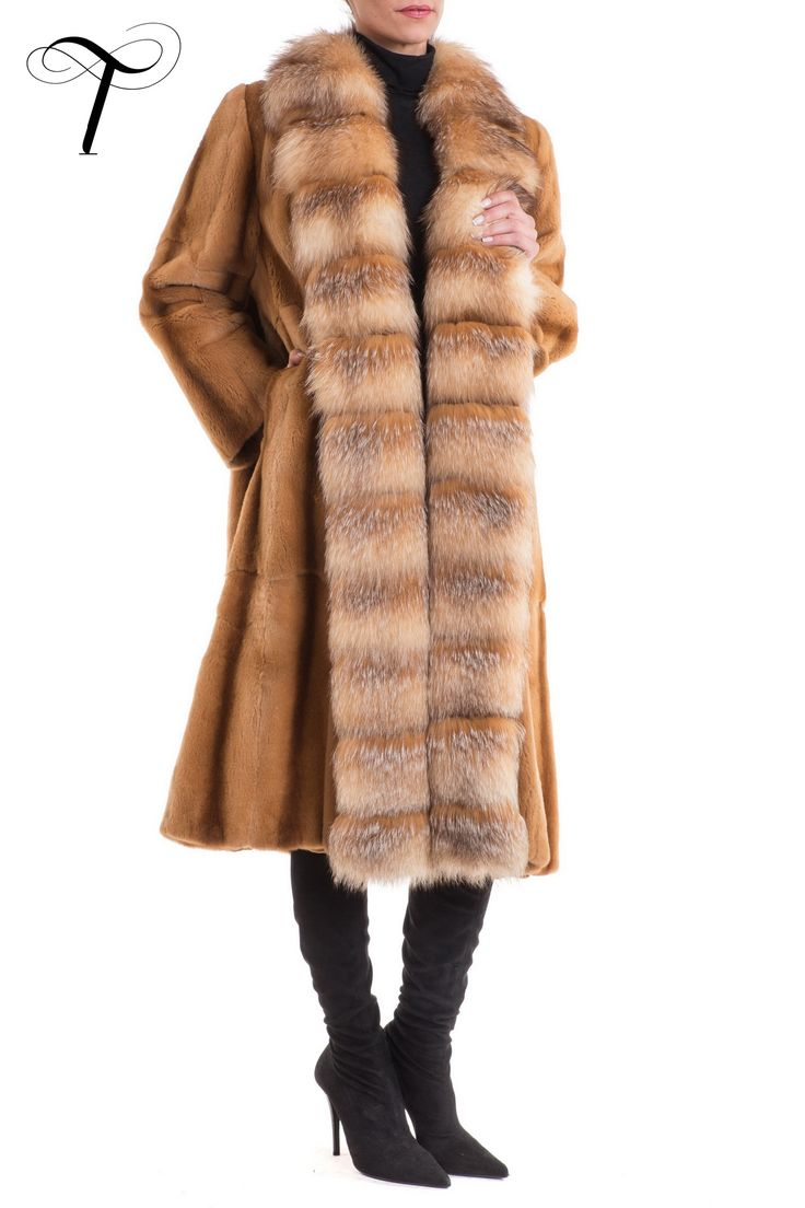 CRYSTAL FOX FUR TRIM SHEARED WEASEL DUSTER COAT  The #dustercoat shape of this #lavish #furcoat, designed by #toutountzisfurs, makes it an #elegant and #stylish #outwear for your #winter outings. Crafted from sheared weasel #fur, it has an open front, trimmed with crystal #foxfur which provides an extra touch of #luxury. The #coat has slit pockets and #satin lining. Effortlessly paired with both denims and evening dresses, it will undoubtedly be a #timeless addition to your #winterwardrobe.