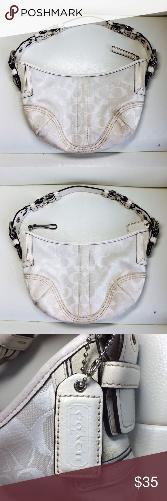 White Coach Hobo Bag NWOT coach hobo bag!! Has lots of room with one pocket no stains inside or out!! Little signs of wear on the braided buckled straps!! Coach Bags Hobos