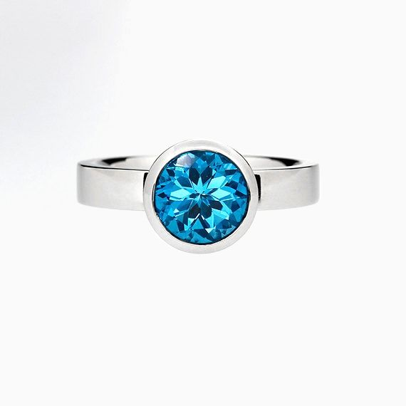 Bezel engagement ring with Swiss Blue Topaz in Palladium