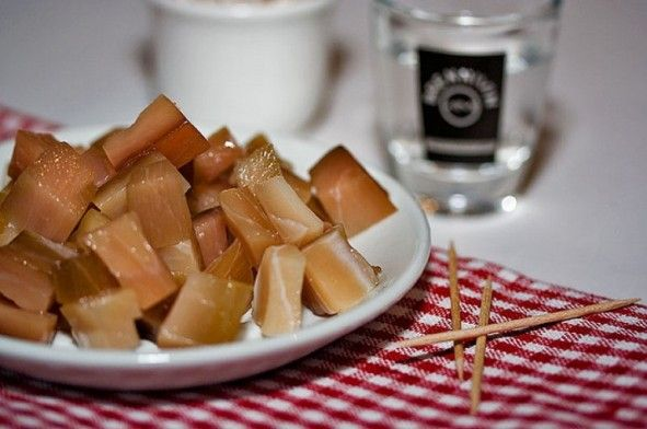 Food eaten at Þorrablot: Hákarl- fermented  shark is served in small cubes as an appetizer.  The taste is so bad that you will have to wash it down with a shot of Brennivin (schnapps).