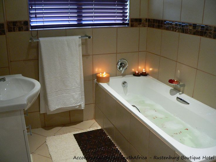 En--suite bathroom at Rustenburg Boutique Hotel. http://www.accommodation-in-southafrica.co.za/NorthWest/Rustenburg/RustenburgBoutiqueHotel.aspx