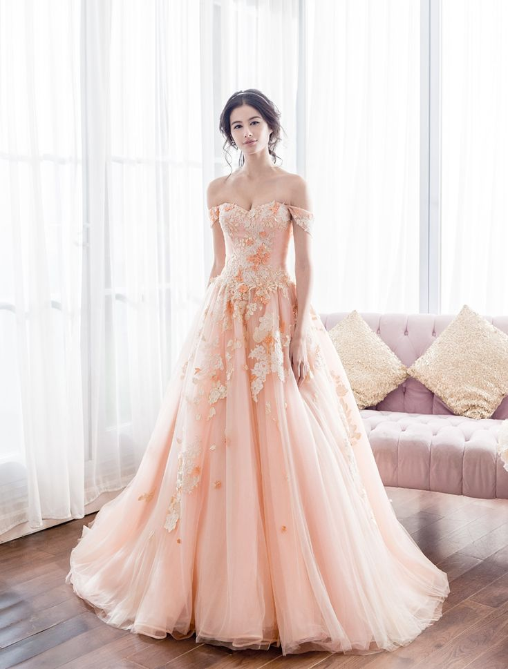 Sweet, feminine, romantic, and refreshing, peach has become one of the hottest trends in recent weddings! The color is a sophisticated blend of both contemporary and classic elegance, making peach dresses a great alternative for traditional gowns. Its soft touch and dreamy tone are perfect for graceful brides. Here are some of our favorite gowns in peach, let's dive in!