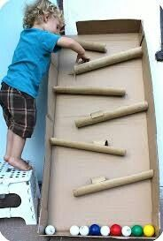 Paper towel rolls, cardboard pieces, and, golf balls to make a fun arcade game!