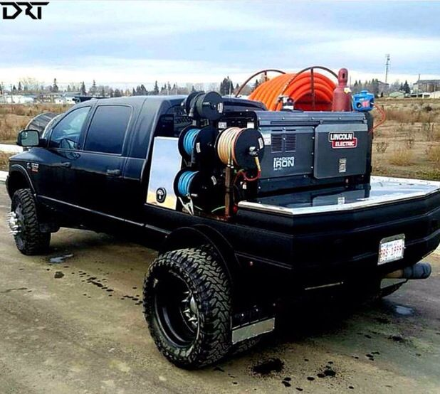 This Dodge Cummins flatbed welding rig is a beast! Pretty sure any welder would love this truck. #Dodge #Cummins #MegaCab #FlatBed #Weld #Welding #Black