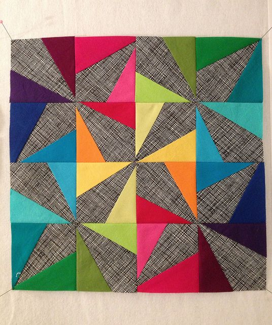 """Yummy, yummy """"Wonky Pinwheel"""" block by Maureen Kelly. Love the brights against this grey background."""