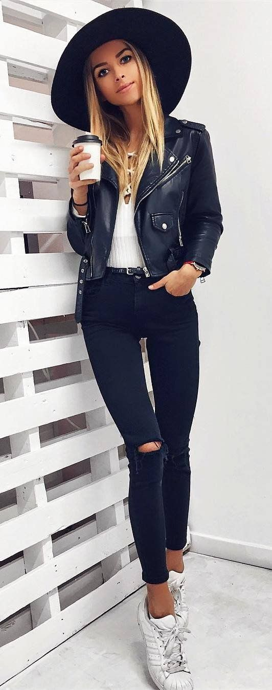 how to style a hat : leather jacket + white lace-up top + rips + sneakers