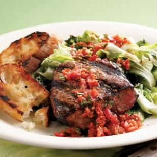 Grilled Beef Tenderloin & Escarole - Lightly grilled escarole combined with tangy tomato vinaigrette makes an irresistible accompaniment to juicy beef tenderloin. Serve with grilled baguette.