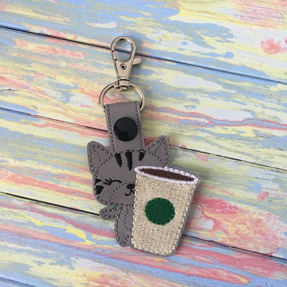 Featured is a cat keychain. This kitty cat loves a good brew so much that her large coffee is as big as she is. Meow!  Fun uses… - Makes for Cat and Coffee Lovers - Backpack Tags - Clip it on your purse - Attach to a lunch box - Memorable Party Favors - Birthday Gifts - Stocking Stuffers - Luggage Tag - Classmates Gifts - Not just for keys. Attach it to your children's items to help them distinguish their stuff  For orders, larger than 5 keychains please send me a direct message for a…