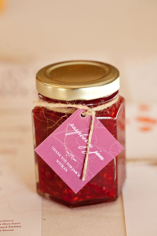 little jars of strawberry jam as favors.  This is happening for sure!!!!!!  I had this in mind before I was even engaged!  Hoping for silver tops though.  Also looking to make a sticker label on theknot.