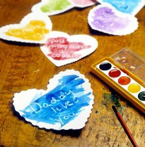 Secret Messages - watercolor hidden word valentines Cut hearts from white paper and write love notes on them with a white crayon, then hide your hearts in strategic morning locations. Place a box of watercolors at the breakfast table, and brush paint over the hearts to reveal the messages.