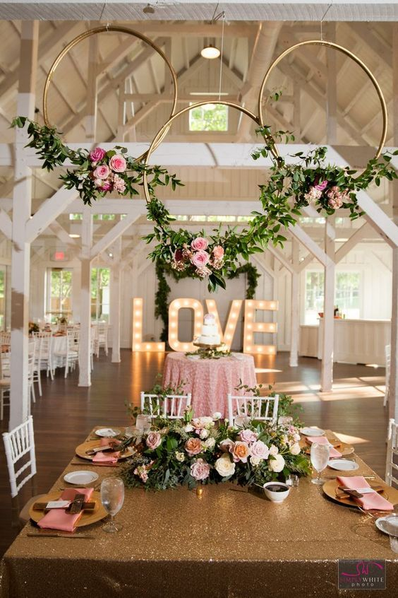 Gorgeous Reception Area at Spain Ranch. Pink and Gold Wedding Color Schemes. Rustic Floral and Wooden Center Pieces #goldwedding #weddingdecor #weddingreception