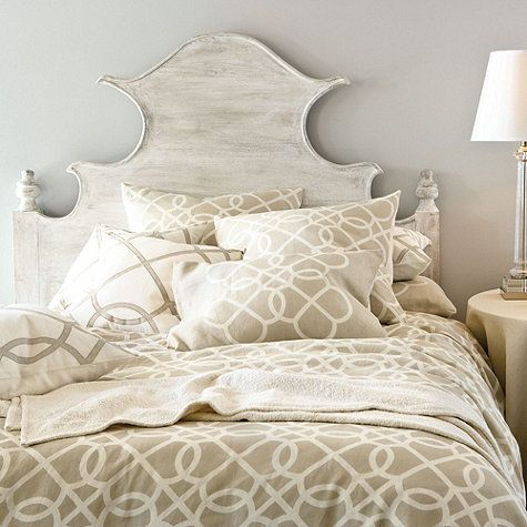 The graceful curves and dramatic scale of our wood Claudette Headboard are accentuated with a rolled edge and a carved bird detail you can pivot or remove for versatility. To achieve the warm, weathered look, artisans sandblast the solid hardwood planks, and then drag the surface with a brush to add the finish color.  Claudette Headboard features: Turned finials echo the soft linesFinishing techniques create rich textureHand crafted of mango wood