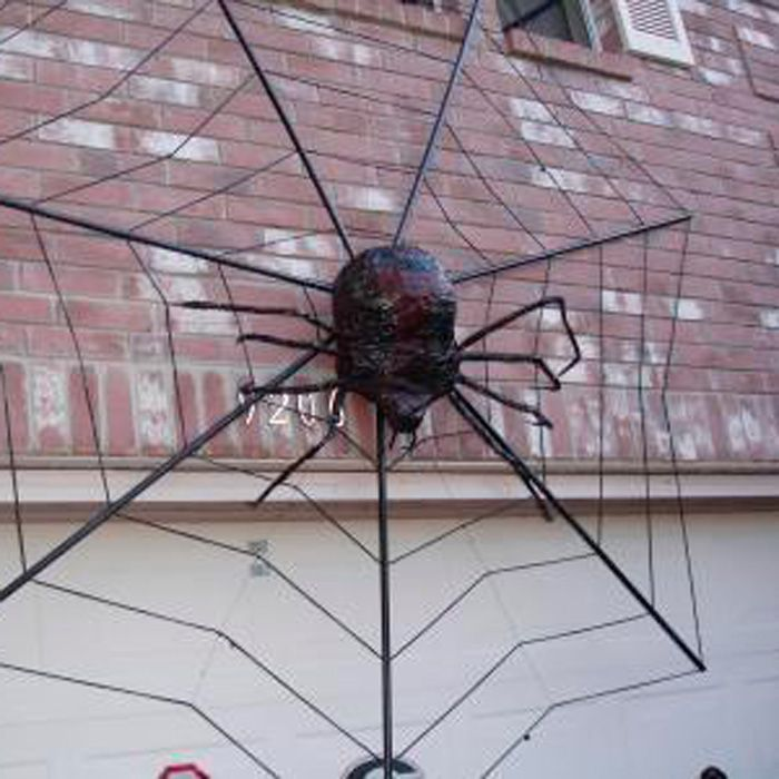 halloween spider web house decoration user beaudiford from texas created a giant halloween decoration using material