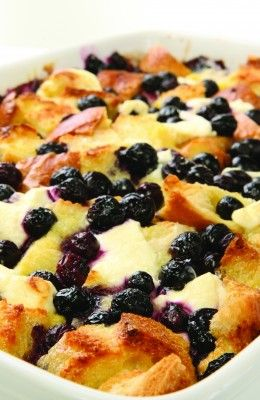 BLUEBERRY BREAKFAST CASSEROLE:   2 C fresh blueberries,   8 large eggs,   1/4 C maple syrup,   1 loaf bread,   1 1/2 C low fat milk,   4 oz low fat cream,   1/4 C butter,   cooking spray,   45 min @ 350