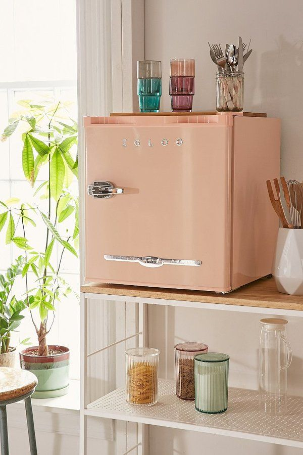 Mini Refrigerator Get extra chilled storage with this retroinspired mini fridge. Features builtin bottle opener + pull handle for easy access. Includes 2L door basket, ice cube tray + slide out shelf for plenty of storage options