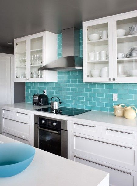 fab turquoise subway tile. I like the colour scheme, grey walls, white cupboards, turquoise splashback, I was thinking wooden counter tops though...