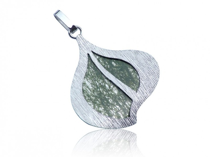 Silver handmade pendant with natural leaves laminated