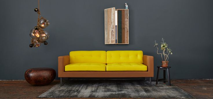 Dark grey wall and yellow Tardi Sofa by Lindsey Adelman // The ...
