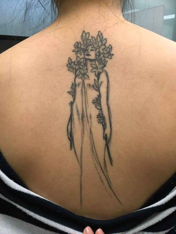 """A sketch of """"Lily"""" from Alphonse Mucha's Flower Series. Healed tattoo done by Jennifer Lawes from Pearl Harbor Gift Shop in Toronto Canada."""