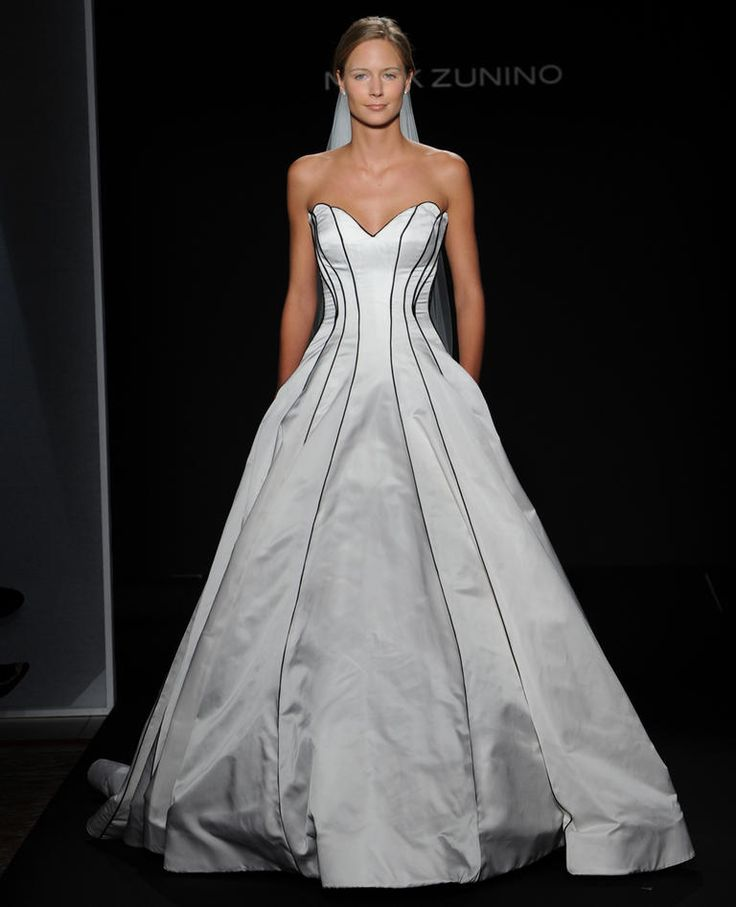 Mark Zunino Fall 2016 off-white duchess satin ball gown wedding dress with black inset piping detailing | https://www.theknot.com/content/mark-zunino-wedding-dresses-bridal-fashion-week-fall-2016