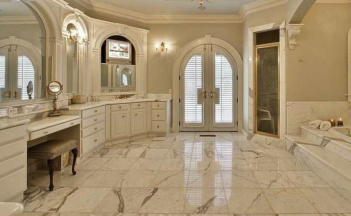 Master bathroom suite calcutta gold marble countertops tub surround steps and tile floor - Bathroom designs kolkata ...