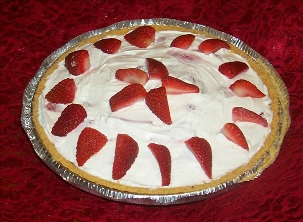 Strawberry Pie. 1 (8 ounce) package cream cheese 1 (8 ounce) container Cool Whip 1 cup confectioners' sugar 2 cups strawberries, quartered 1 graham cracker pie crust