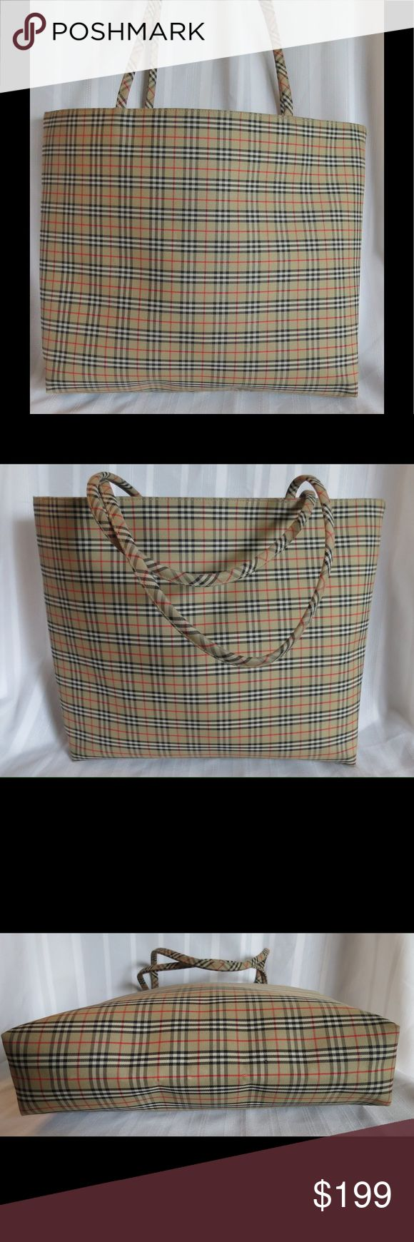 """HUGE Vintage AUTHENTIC Burberry Plaid Tote Bag HUGE Vintage AUTHENTIC Burberry Plaid Tote Bag Shopper     Approx  Measurements : 17"""" X 13"""" 3"""" deep  Strap 10"""" drop. Really beautiful condition especially for vintage, clean lining, outside is pretty immaculate, just light light signs of wear on the bottom, I have take photos, overall truly excellent. All of my items are Guaranteed 100% Genuine I do not sell FAKES of any kind   No Trades (S095014) Burberry Bags"""