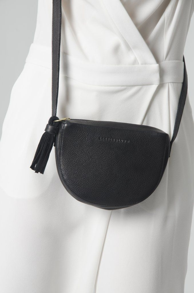 """AS X LL - The Lucy ( Black )    Abigail Spencer x Larsen & Lund Capsule Collection   """"The Lucy""""   Named after Abigail's character on Timeless.    This effortlessly stylish bag is an everyday staple and holds all of your essentials. Made from Italian leather and featuring a satin-finish, brass hardware and Riri zipper, imported from Switzerland.   Lined in cotton chambray, and has an adjustable strap.    Measurements: 7 1/2""""w x 5 1/2""""h x 2""""d    Handcrafted in Los Angeles."""