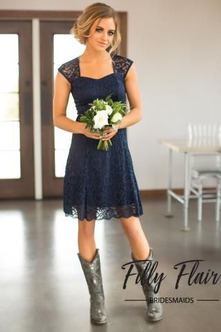 The perfect and classic dress for any wedding and any season! This beautiful lace bridesmaid dress is complete with a capped sleeve and a cut out back, making this one unforgettable navy bridesmaid dr