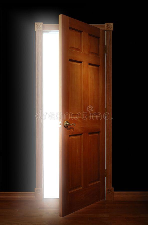 Door Of Opportunity Door Opening With Bright Light Illuminating A