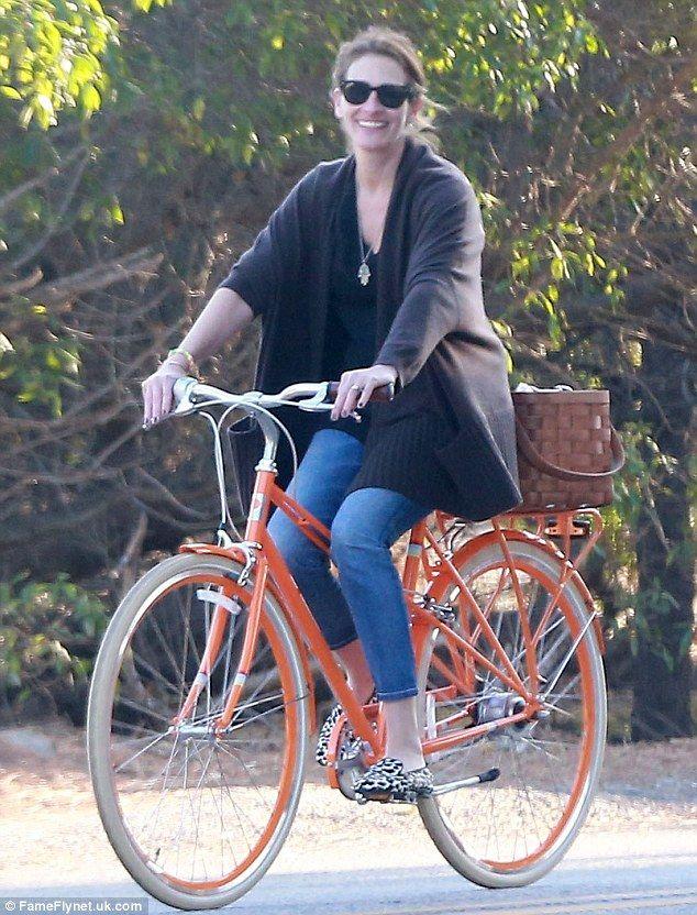 Bike beauty: Julia Roberts enjoyed a family bike ride on Sunday in Malibu...on the iconic mixte frame PUBLIC M7i Bike in orange.