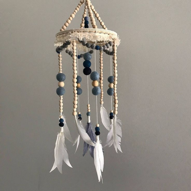 Boho Baby Mobile At Wild eli we offer an arrange of felt ball mobiles and garlands to compliment your baby's nursery or toddlers room. They are all hand made with the highest of detail and designed to last the test of time. Love the design but the colours aren't what you are looking for