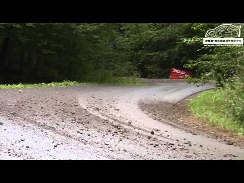Mitsubishi Lancer rally racer gets up on two wheels but still keeps his cool and lands it to make the next corner. Rally drivers = mad skills!