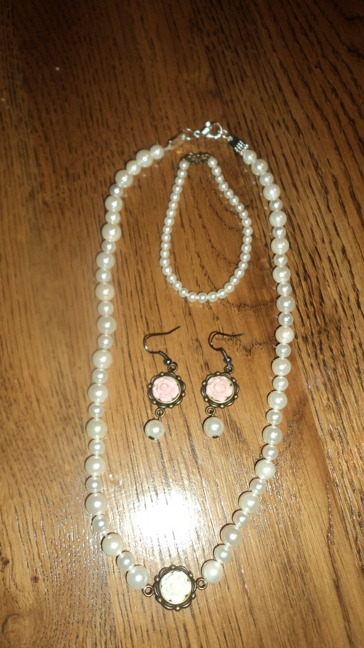 white necklace, pink roses earrings and bracelet, $ 35