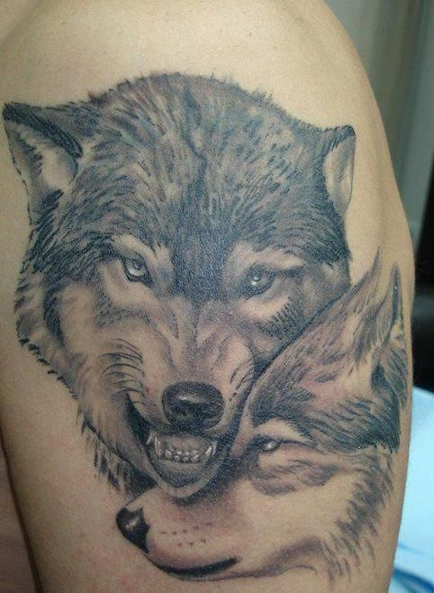 wolf guards his female tattoo – Wolf tattoos
