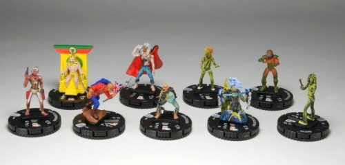 """At long last, Iron Maiden fans will be able to add Eddie to their tabletop adventures!  Featuring nine different figures with ALL-NEW dial designs, the Iron Maiden HeroClix: 24 Ct. Gravity Feed is a fantastic addition to both Iron Maiden and HeroClix collections alike!  This special HeroClix collection draws its inspiration from the incredible artwork featured on Iron Maiden albums; images such as """"The Trooper,"""" """"Powerslave,"""" """"Somewhere in Time"""" and MORE are now immortalized as HeroClix!"""