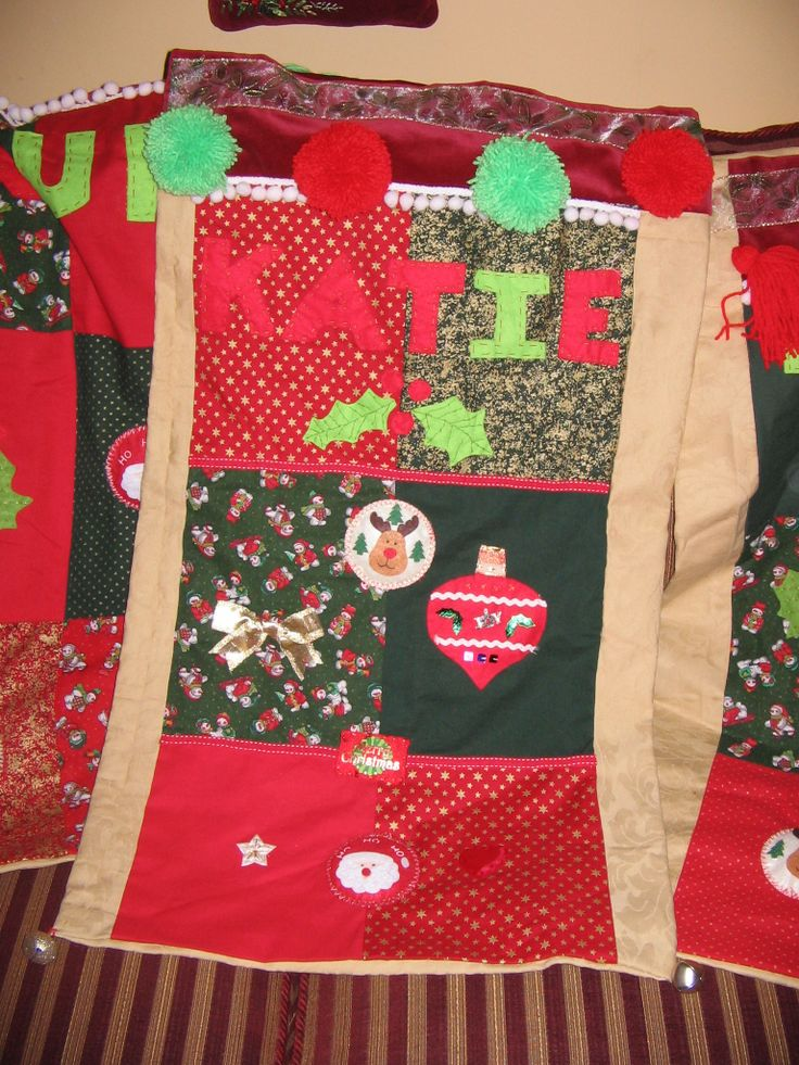 A Christmas sack from old curtains some Christmasy fat quarters and felt and woolly pompoms with odd bits of Ribbon