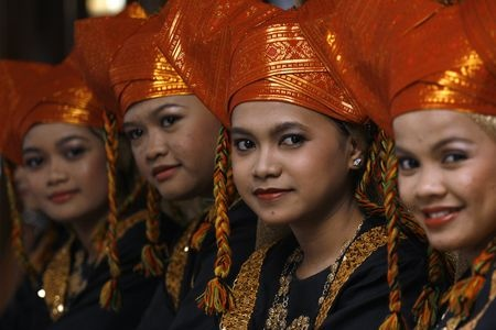 Indonesian Girl in their Traditional Minangkabau Dress waiting to perform a traditional dance. Photo by Kabir Malek -- National Geographic--Your Shot