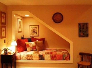 Under stairs nook, maybe a bed could fit