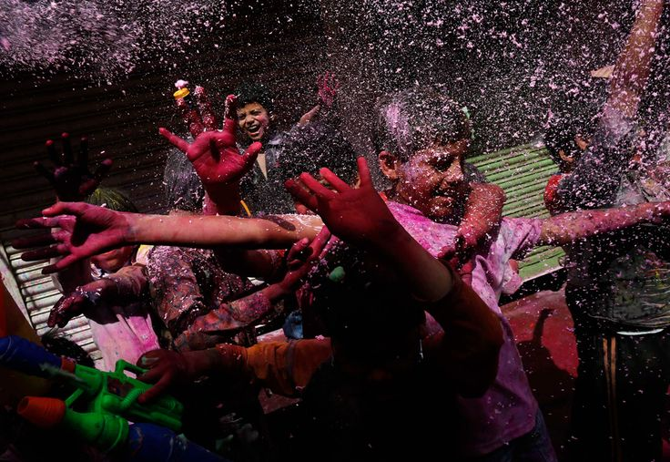 Boys spray colored foam during Holi celebrations at a lane near the Bankey Bihari temple in Vrindavan, in the northern Indian state of Uttar Pradesh March 26, 2013. (Adnan Abidi/Reuters)