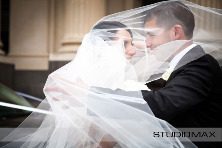 A big beautiful veil is such a fun photography prop. A great way to get gorgeous natural smiles.  Captured by Melbourne Wedding Photographers STUDIOMAX
