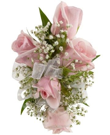 ROSE CORSAGE, PINK - A corsage with five pink sweetheart roses and babies breath. Designed as a wrist corsage, but can be converted to a pin on corsage with included pins. Item #4404.