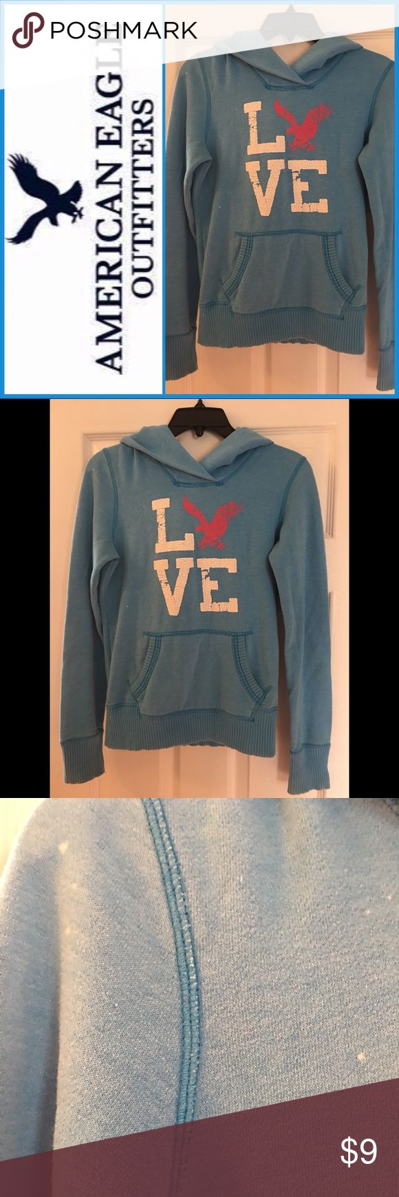 Women's American Eagle Logo Hoodie Women's American Eagle Logo Hoodie ▪️Used. Please refer to pics for the small white specks located on parts of sweatshirt. And extra wear on logo (was bought with logo wear already/supposed to be that way) ▪️Size: XS/TP ▪️Style: Hoodie with front pocket ▪️Color: Blue ▪️Material: 60% Cotton/40% Polyester ▪️Made: Vietnam American Eagle Outfitters Tops Sweatshirts & Hoodies