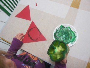 One way we have been exploring healthy foods in preschool is by making different kinds of pizza. Today we made veggie pizzas.    For our veggie pizzas, the children dipped red, green, and yellow peppers into red, green, and yellow paint...
