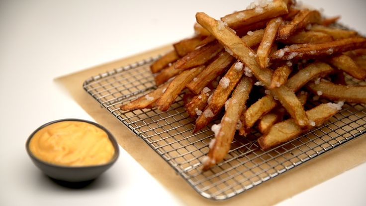 Recipe with video instructions: Super crispy, gluten-free tempura fries are all the fried perfection we want. Ingredients: 2 qt oil, 1 ½ cups soda water, 3 cups potato starch, 2 Idaho potatoes, cut into long, skinny fries, Salt to taste